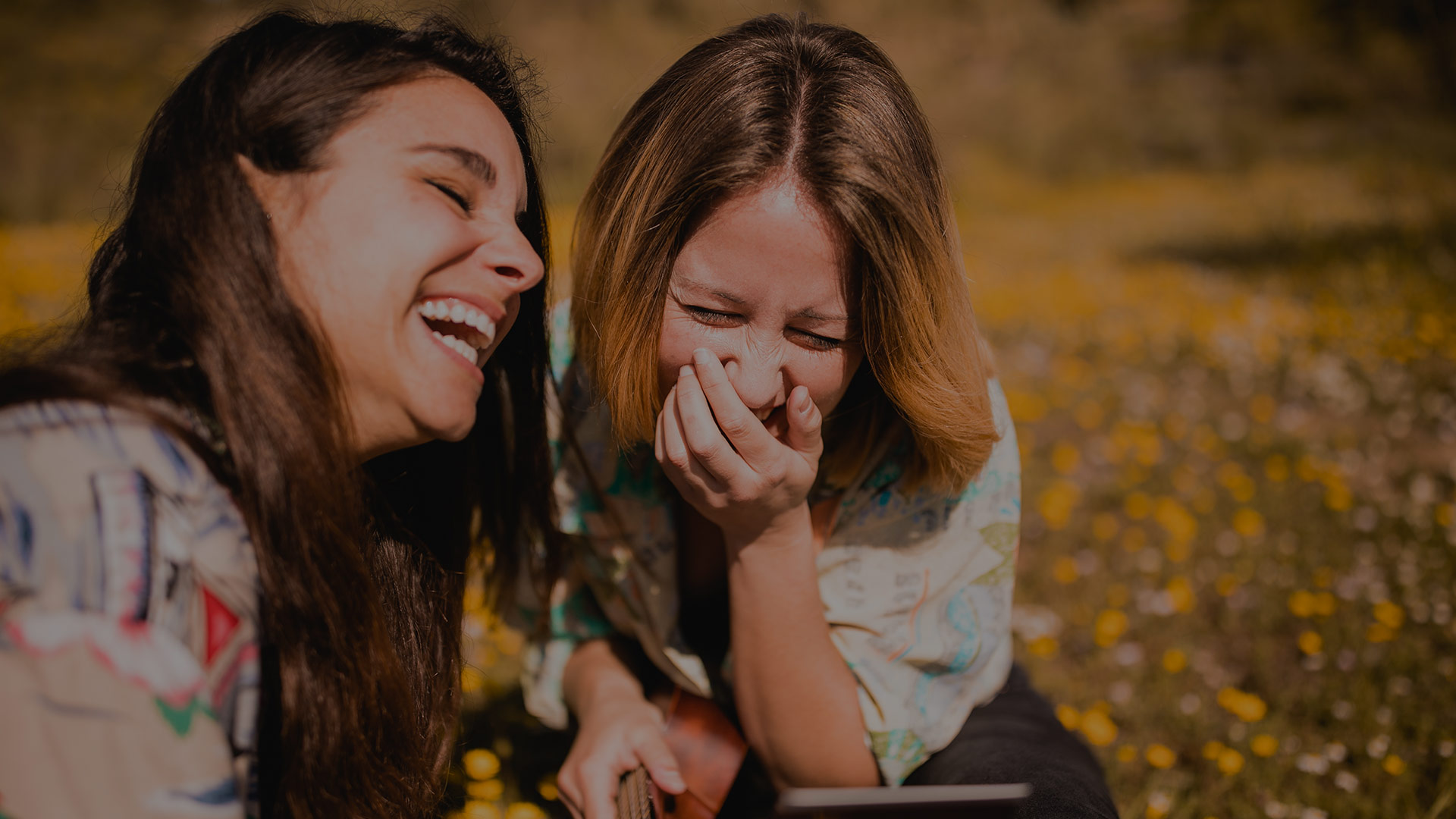 Laughing girls on meadow