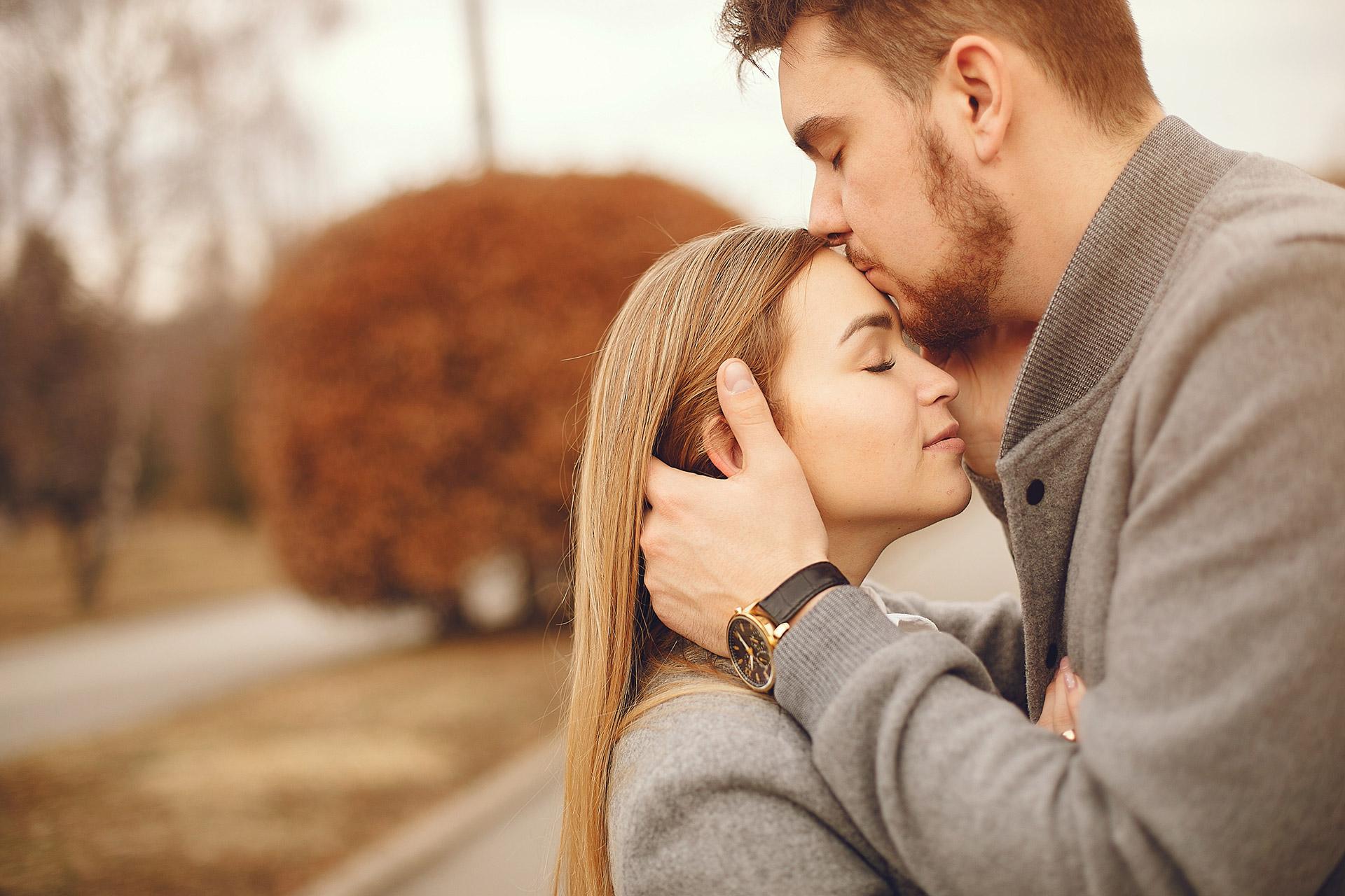 Loving couple kissing in park